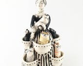 Crazy Cat Lady with cats in her dress pockets ceramic figurine fine art