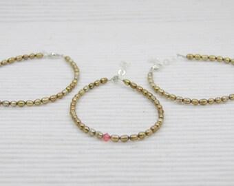 Set of stackable pearl bracelets