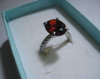 Beautiful Sterling and Red CZ RIng with Clear CZs Around the Band Marked 925 MA?