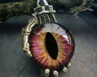 Gothic Steampunk Robot Claw Pendant with Golden Flame Eye