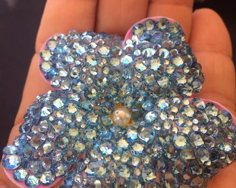Mini megawatt Swarovski aquamarine-colored  hair flower with swarovski pearl at center