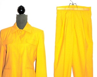 Luxurious vintage 80s canary yellow  rayon blend suit.Made by Valentino, Giovanni. Rome, Paris, London, Beverly Hills. Size Medium.