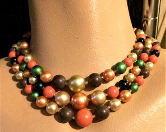 Vintage Madmen 17 Inch Three Strand Bead Necklace in Orange, Pearly Peach, Brown, Pearly Cream, Green, and Black. Made in Japan.  (D14)