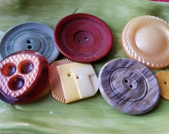 Vintage  Button, 7 large assorted styles and colors,  celluloid  (feb 5l8 17)