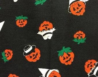 Vintage Black Fabric With Orange Jack O' Lanterns On It
