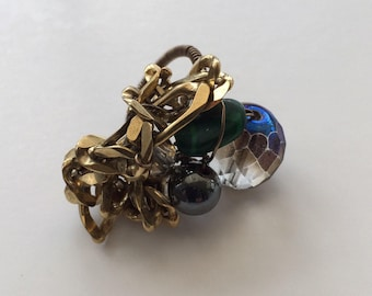Grey green and gold bling ring