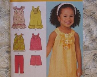 Simplicity Pattern - Girl's Summer Dress - # 1673A - Size 1/2  - 4