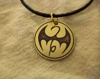 Marvel's Iron Fist Etched Brass Pendant