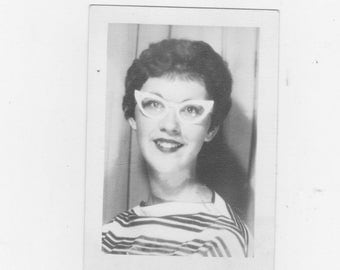 original 1950s black and white photo. of a pretty girl wearing cat eye glasses