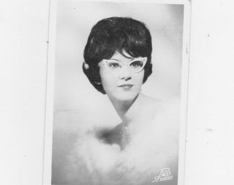 original 1950-60 s black and white photo. of a pretty girl wearing cat eye glasses
