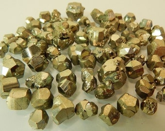 Pyrite crystals - mineral specimens small rocks - fools gold - golden metallic geometric shape octohedron octohedral dodecahedron cube stars