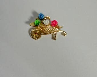 Vintage Gold tone Wheelbarrow with lucite Flowers and tiny Rhinestones. Signed LISA.