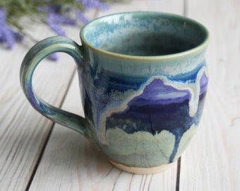 Handcrafted Coffee Cup Dripping Blues and Purple Glazes Handmade Pottery Mug Wheel Thrown Stoneware Ready to Ship Made in the USA