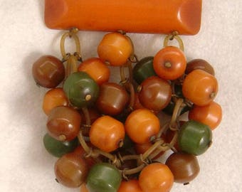 VTG BAKELITE dangle Pin brooch with bakelite bead Dangles on Celluloid chain