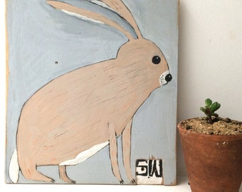 Painting on reclaimed wood of a hare