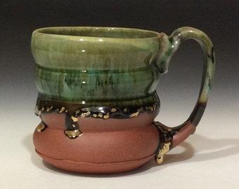 Drippy glaze mug with gold accents