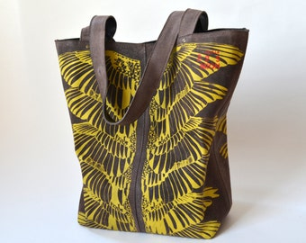 Brown leather tote with yellow print