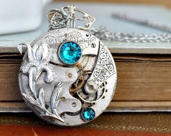 steampunk jewelry, steampunk necklace, antique Elgin movement, LOVE TAKES TIME,  antique silver iris flower necklace Steampunk, blue zircon