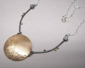 Hammered, textured, brass lunar disc and long, oxidized sterling links with rainbow moonstones necklace