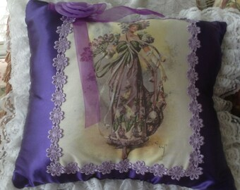 Victorian girl in purple hat with flowers  13x12