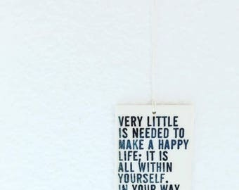 porcelain wall tag screenprinted text very little is needed to make a happy life; it is all withing yourself... - aurelius