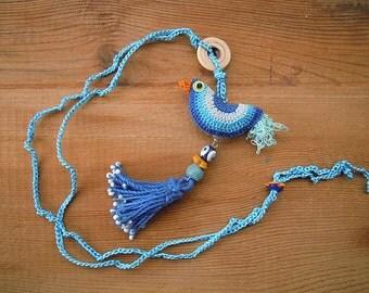 tassel necklace with crochet bird, blue, evil eye