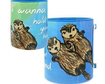 Sea Otters Holding Hands Blue Mug by Pithitude