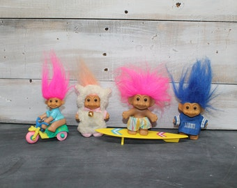 Lot of Four Vintage Russ' Troll Dolls, Lamb, Surfer, Detroit Lions, Biker