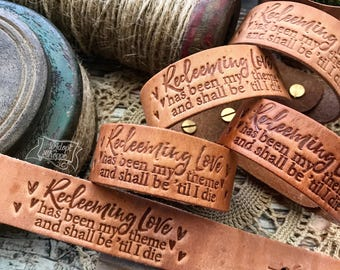 redeeming love has been my theme and shall be 'til i die hymn leather cuff (natural camel)