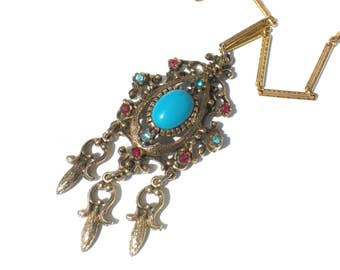 Blue and Gold Necklace with Ornate Rhinestone Pendant with Red and Aqua Blue Rhinestones - Vintage Jewelry Signed Celebrity