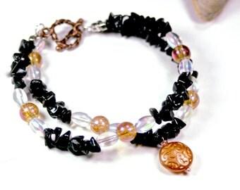 Orange amber glass black onyx gemstone bracelet double strand