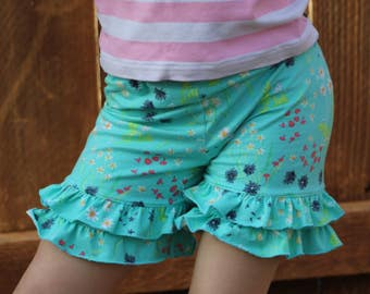 green/blue shorties with floral print.  sizes 12m - 14 years.  fabric by Art Gallery