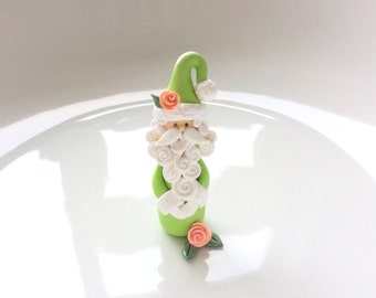 Christmas decoration ornament Santa Claus in green handmade from polymer clay