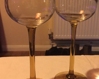 A pretty vintage pair of brown/ amber stemmed hock glasses.