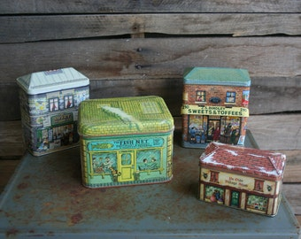 Set of Four Vintage City-Scape Tin Cannisters