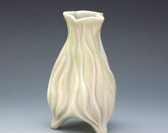 Small porcelain bud vase in pale yellow, carved with curvy grooves