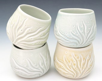 Carved porcelain cup in pastel glaze, yellow, baby blue, green, tea bowls