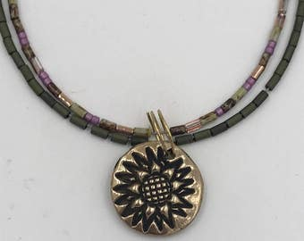 Sunflower Pendant | Beaded Necklace | Bronze | 36.00 | Purple and Green Beads | The Bleu Giraffe