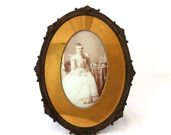 ON SALE Antique Victorian oval brass CDV photo frame with sepia portrait of young woman, oval vintage ornate photo frame, curved glass