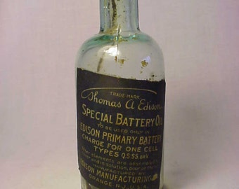 c1890-1900 Thomas A. Edison Special Battery Oil Edison Manufacturing Co. Orange, N.J., Rare Aqua Battery Charge Bottle with the paper label
