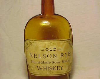 c1890s Old Nelson Rye Hand Made Sour Mash Whiskey, Amber Pint Size Strap Side Flask with the Original Paper Label