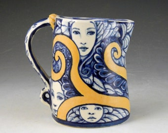 Pitcher in Blue white and yellow OOAK hand painted with faces