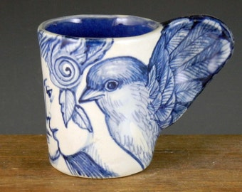 Bird cup blue and white porcelain with two women wing