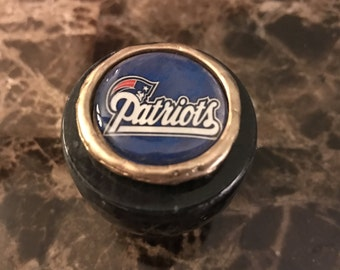 Unique solid marble top wine bottle stopper adorned with a New England Patriots inspired image