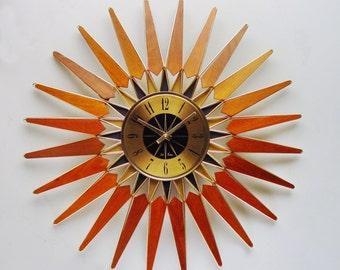 Starburst Clock, 1960s, by Seth Thomas. Mid Century Danish Modern / Atomic Era Sunburst Wall Clock. 23 inches