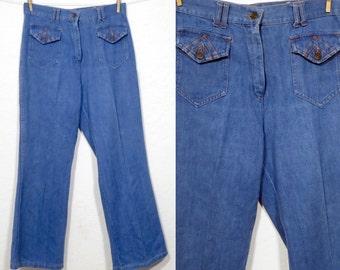 Vintage Womens 1970s High waisted denim jeans. Wide leg. 31 waist 40 hip