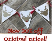 White wooden banner with deer silhouette