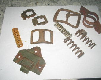 belt buckles, springs,  rust, steampunk, Industrial Art