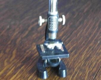 vintage small plastic microscope