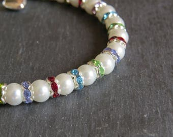 pretty pearl bead and diamante spacer bracelet with silver plated heart